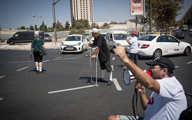 Disabled activists block a road in Jerusalem on September 18, 2017. (Yonatan Sindel/Flash90)
