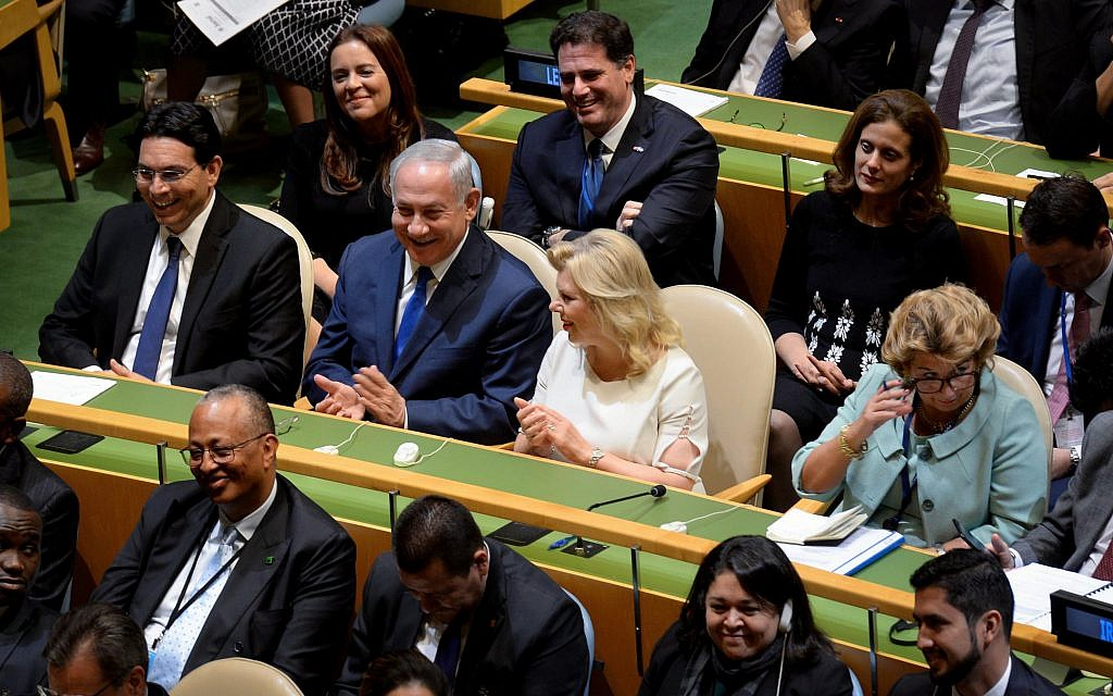 Prime Minister Benjamin Netanyahu and his wife Sara listen to US president Donald Trump address the UN General Assembly at UN headquarters in New York on September 19, 2017. (Avi Ohayon/GPO)