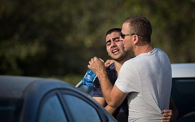 Local residents at the Har Adar settlement, outside Jerusalem, on September 26, 2017, pictured after a Palestinian terrorist killed two security officers and a border policeman there, and seriously injuring another man. (Hadas Parush/FLASH90)