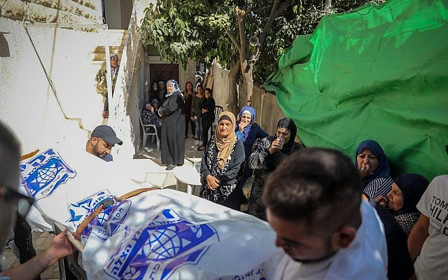 Friends and family carry the body of Youssef Ottman, 25, during his funeral in Abu Ghosh, September 26, 2017. Ottman was killed on Monday morning after a Palestinian terrorist opened fire on a group of security guards at the entrance to Har Adar outside Jerusalem. (Hadas Parush/Flash90)