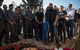 Friends and family of Youssef Ottman during his funeral in Abu Ghosh, September 26, 2017. Ottman was killed on Monday morning, after a Palestinian terrorist opened fire on a group of security forces at the entrance to the Israeli settlement of Har Adar, outside Jerusalem. (Hadas Parush/Flash90)