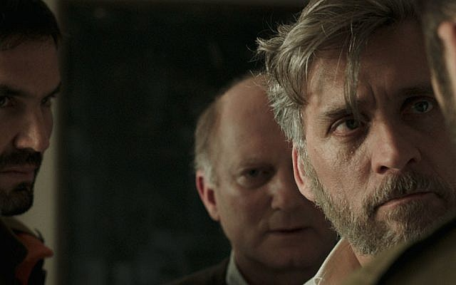 Lior Ashkenazi (foreground), stars as a grieving father in Samuel Maoz's award-winning film 'Foxtrot' (Courtesy 'Foxtrot')