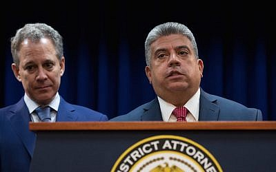 (L to R)  New York State Attorney General Eric Schneiderman looks on as Acting Brooklyn Attorney General Eric Gonzalez speaks during a press conference to call for an end of Immigration and Customs Enforcement (ICE) raids in New York state courts, August 3, 2017 in the Brooklyn borough of New York City. (Drew Angerer/Getty Images via JTA)