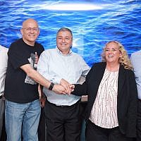 Microsoft Israel CEO, Shelly Landsmann, second from right, with Bank Hapoalim CEO Arik Pinto, center, and Yoram Yaacovi, general manager, Microsoft Israel R&D Center, September 6, 2017 (Courtesy Bank Hapoalim)