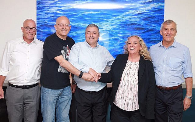 Microsoft Israel CEO, Shelly Landsmann, second from right, with Bank Hapoalim CEO Arik Pinto, center, and Yoram Yaacovi, general manager, Microsoft Israel R&D Center; September 6, 2017 (Courtesy Bank Hapoalim)