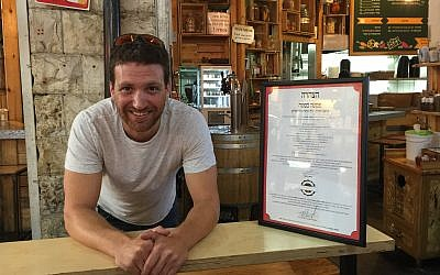 Haim Avrahami, one of the two owners of Pasta Basta, a popular restaurant in Jerusalem's Mahane Yehuda market. (Jessica Steinberg/Times of Israel)