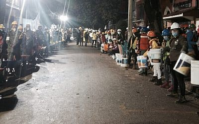 Rescuers from Mexico and Israel search for survivors on September 22, 2017, three days after a strong quake hit central Mexico. (iAid)