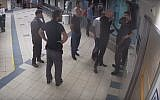 Screen capture from video of a group of men confronting security guards in the ER unit of Ichilov Hospital, Tel Aviv, September 27, 2017. (YouTube/Times of Israel)