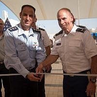 Col. Liran Cohen, head of the IDF's air defense school, left, and Col. David Shank, of the US 10th Army Air & Missile Defense Command, cut the ribbon to open the first American military base in Israel, inside the Mashabim Air Base, on September 18, 2017. (Israel Defense Forces)