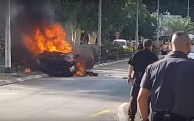 Police gather at the scene of a suspected gangland car bombing in the northern city of Nesher on September 11, 2017. (Screen capture: YouTube)