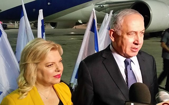 Prime Minister Benjamin Netanyahu and his wife Sara speak to reporters before boarding the plane to Latin America for a 10-day state trip, on September 10, 2017. (Raphael Ahren/Times of Israel)