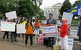 Refugees, advocates and faith leaders rallying in front of the White House to call for refugee protections on World Refugee Day, June 20, 2017. (HIAS via JTA)