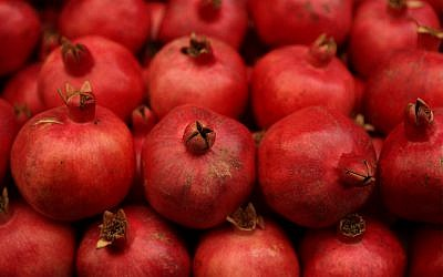 Pomegranates at the Mahane Yehuda market in Jerusalem on August 25, 2016. (Nati Shohat/Flash90)