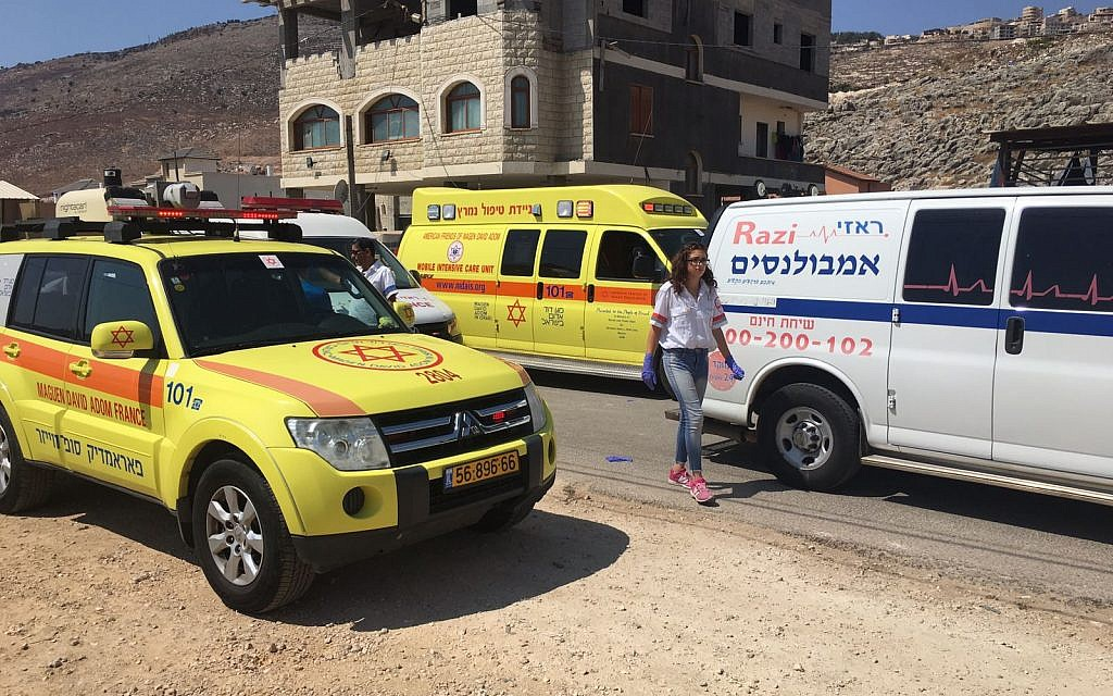 Magen David Adom paramedics at the entrance to the Israeli-Arab town of Majd al-Krum in the upper Galiliee where a woman was shot dead, September 10, 2017. (Magen David Adom)