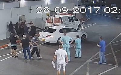 An altercation between security guards and the family of a patient is seen outside the Ichilov Hospital ER, June 27, 2017 (Security camera footage/Courtesy Ichilov Hospital)