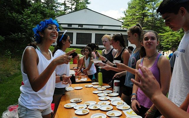 Israeli Staff serve pita and hummus to campers on Israel Day at Camp Tevya in Brookline, New Hampshire. (Amy Blotner/Camp Tevya)