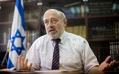 Rabbinical Courts Administration Director Shimon Yaakovi speaking during an interview in his office in Jerusalem, July 27, 2015. (Yonatan Sindel/Flash90/via JTA)