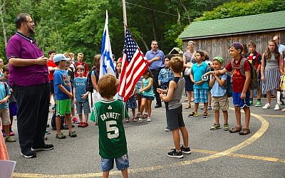 Scott Sokol, head of school at MetroWest Jewish Day School in Framingham, Massachusetts, leads morning circle, one of several camp-like elements the school has adopted. (Courtesy of  MetroWest Jewish Day School/via JTA)