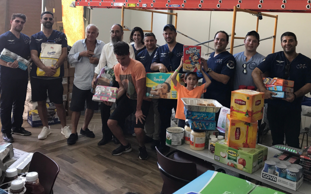 Eli Rowe's team of 12 delivered supplies to the San Juan Chabad, as well as to vulnerable areas throughout Puerto Rico's capital, September 25, 2017. (Courtesy of Rowe/via JTA)