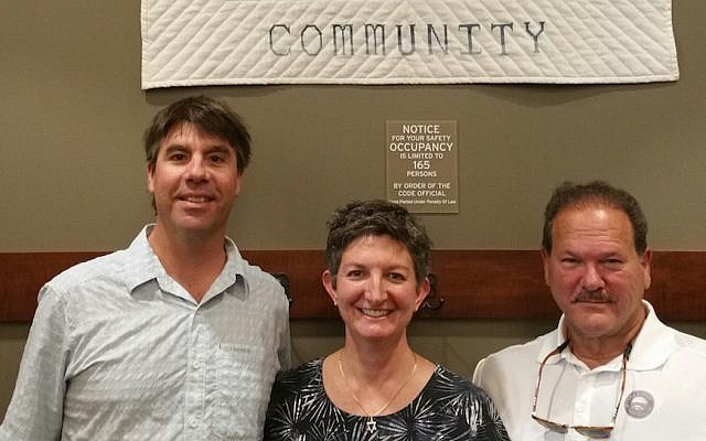 From left: Whitefish Mayor John Muhlfeld, Rabbi Francine Green Roston and Paul Goldenberg, the director of Secure Community Network, August 25, 2017. The Jewish community in the Montana city was subjected to an onslaught of anti-Semitic harassment over the past year. (Courtesy of Goldenberg/via JTA)