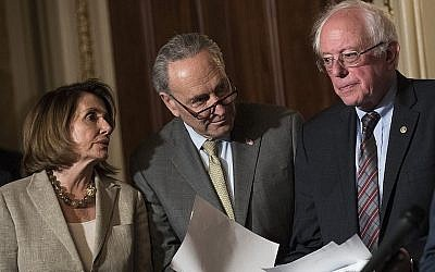 From left to right: House Minority Leader Nancy Pelosi, Senate Minority Leader Charles Schumer and Sen. Bernie Sanders at a Capitol Hill news conference, May 25, 2017. (Drew Angerer/Getty Images)