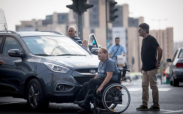 One of a group of disabled individuals and social activists who blocked the entrance to Jerusalem in their campaign for a rise in disability stipends, September 18, 2017. (Yonatan Sindel/Flash90)