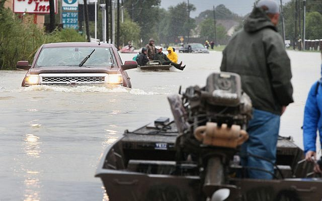 Rescue workers and volunteers helping residents make their way out of a flooded neighborhood in Houston following Hurricane Harvey, August 29, 2017. (Scott Olson/Getty Images)