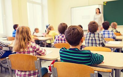 Illustrative image of school children and teacher in classroom. (dolgachov, iStock/Getty Images)