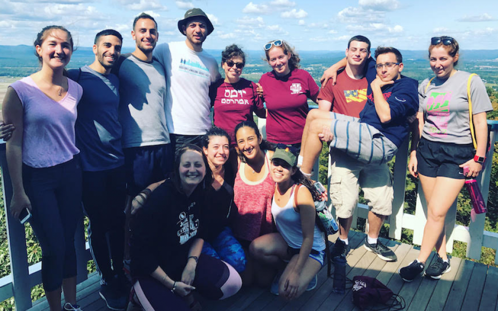 Ben Avrahami, second from left, standing, participating in a hike with other members of IAC Mishelanu at the University of Massachusetts. (Courtesy of IAC Mishelanu UMass Amherst/via JTA)