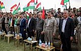 Kirkuk's provincial governor Najim al-Din Karim (3rd-R), who was sacked by the Iraqi parliament the previous week, attends a rally in support of the upcoming independence referendum in Kirkuk on September 19, 2017, accompanied by the former speaker of the Kurdistan parliament and leading member of the Kurdistan Democratic Party, Kamal Kirkuki (2nd-R). (AFP PHOTO / Marwan IBRAHIM)