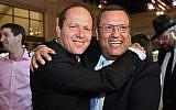 Moshe Lion (R) seen with Jerusalem mayor Nir Barkat, during the wedding of Lion's daughter in Neve Ilan, June 19, 2016. (Yaakov Cohen/Flash90)