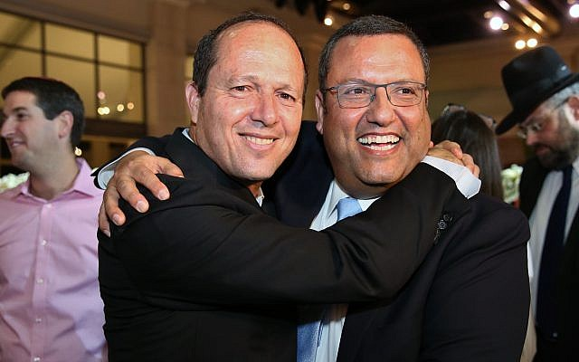 Moshe Lion (R) seen with Jerusalem mayor Nir Barkat, during the wedding of Lion's daughter in Neve Ilan, June 19, 2016. (Yaakov Cohen/Flash90)