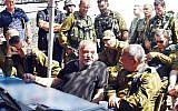 Defense Minister Avigdor Liberman, center, speaks with IDF Chief of Staff Gadi Eisenkot, right, as the head of the Northern Command, Maj. Gen. Yoel Strick, right, watches on, during a visit to a large IDF drill in northern Israel on September 12, 2017. (Ariel Hermoni/Defense Ministry)