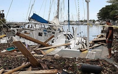 A damaged boat is seen at the Dinner Key marina in Miami, Florida, after Hurricane Irma passed through the area, on September 11, 2017. (Joe Raedle/Getty Images/AFP)
