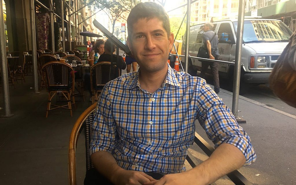 Mike Tolkin, the youngest candidate in the Democratic primary for New York mayor, at a city cafe, Sept. 5, 2017. (Josefin Dolsten/JTA)