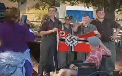 Men attending a Michigan cultural event to re-enact World War ll caused uproar by posing with a Nazi flag for a photograph that went viral on Facebook , September 24, 2017. (Screenshot)
