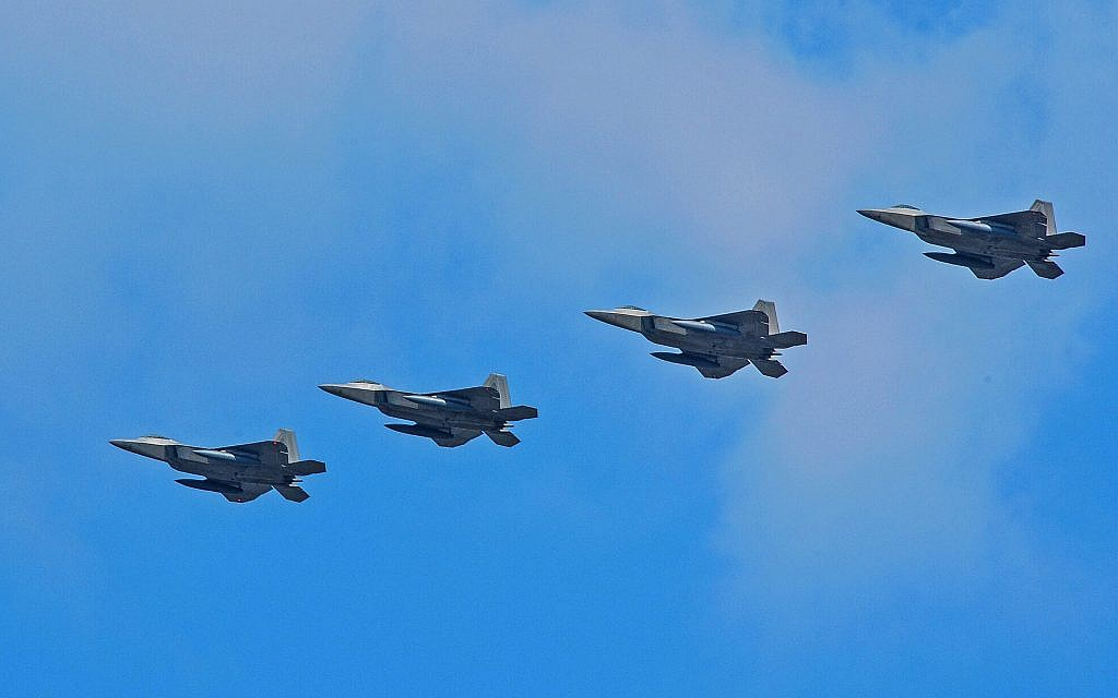 Four US Air Force F-22 Raptor fighter aircraft from Kadena Air Base, Japan, conduct a flyover in the vicinity of Osan Air Base, South Korea, in response to provocative action by North Korea February 17, 2016. (US Air Force/Song, Kyong Hwan)