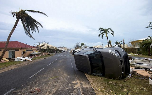 A photo taken on September 6, 2017 shows a car turned onto its side in Marigot, near the Bay of Nettle, on the French side of the Caribbean island of Saint Martin, after the passage of Hurricane Irma. (Lionel Chamoiseau/AFP/Getty Images)