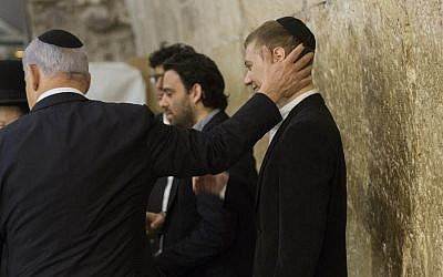 Prime Minister Benjamin Netanyahu and his son Yair visit the Western Wall in Jerusalem's Old City on March 18, 2015. (Yonatan Sindel/Flash90)