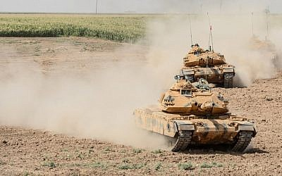 Illustrative: Iraqi and Turkish tanks take part in a military exercise near the border with Iraqi Kurdistan at Silopi district in Sirnak on September 26, 2017. (AFP Photo/Ilyas Akengin)