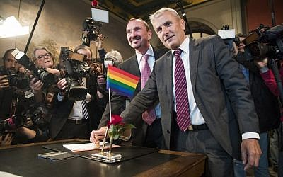 Bode Mende (R) and Karl Kreile stamp their marriage certificate as they become Germany's first gay couple to be legally married, tying the knot at the Schoeneberg town hall in Berlin on October 1, 2017. (Odd Andersen/AFP)