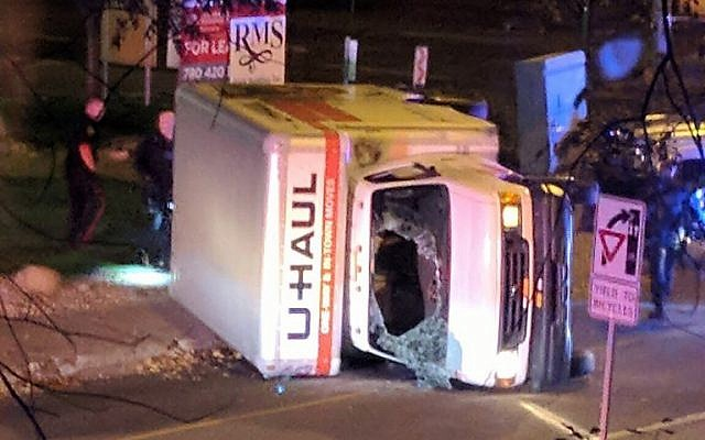 A rental truck lies on its side in Edmonton, Canada, on October 1, 2017, after a high speed chase. (Michael Mukai/AFP)