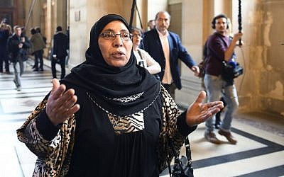 Zoulikha Aziri, mother of Mohamed Merah, gestures as she speaks to journalists on October 2, 2017 at a Paris court house before the opening of the trial of Abdelkader Merah, who stands accused of complicity in the series of shootings commited by his jihadist brother in Toulouse and Montauban in 2012. (AFP/Eric Feferberg)