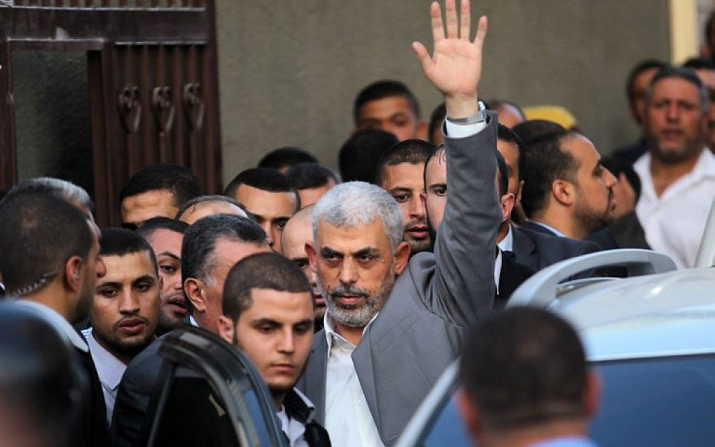 Hamas's leader in the Gaza Strip Yahya Sinwar waves as he arrives for a meeting  with Palestinian prime minister and other officials in Gaza City October 2, 2017. (AFP Photo/Said Khatib)