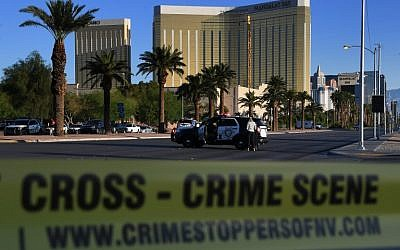 Crime scene tape surrounds Las Vegas's Mandalay Bay Hotel (background) after a gunman killed 59 people and wounded more than 500 others when he opened fire on a country music concert in the city on October 2, 2017. (AFP/Mark Ralston)