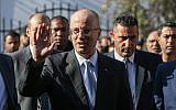 Palestinian Authority Prime Minister Rami Hamdallah arrives at a cabinet meeting in Gaza City on October 3, 2017. (AFP Photo/ Mohammed Abed)