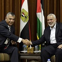 Hamas chief Ismail Haniyeh, right, meets with Egyptian Intelligence Minister Khalid Fawzi at the former's office in Gaza City on October 3, 2017. (AFP Photo/Mahmud Hams)