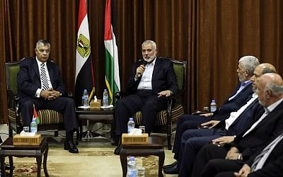 Hamas's overall leader Ismail Haniyeh, right, meets with Egyptian Intelligence Minister Khalid Fawzi at his office in Gaza City on October 3, 2017. (AFP/MAHMUD HAMS)