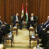 Hamas's leader Ismail Haniyeh (C-R) meets with Egyptian Intelligence Minister Khalid Fawzi at the latter's office in Gaza City on October 3, 2017. (AFP Photo/Mahmud Hams)