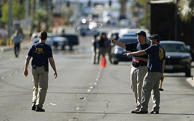 FBI investigators work outside the Route 91 festival venue after a gunman killed more than 50 people and wounded more than 200 others when he opened fire on a country music festival in Las Vegas, Nevada on October 3, 2017.  (AFP/ Mark RALSTON)